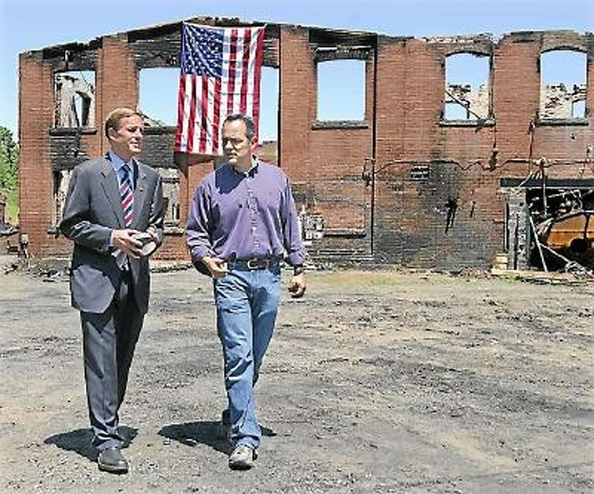 Senator Richard Blumenthal speaks with Matthew G. Bevin, president of the Bevin Brother's Manufacturing after touring the 180 year old bell factory Thursday morning. The 130 year old structure was destroyed by fire Saturday night. Catherine Avalone