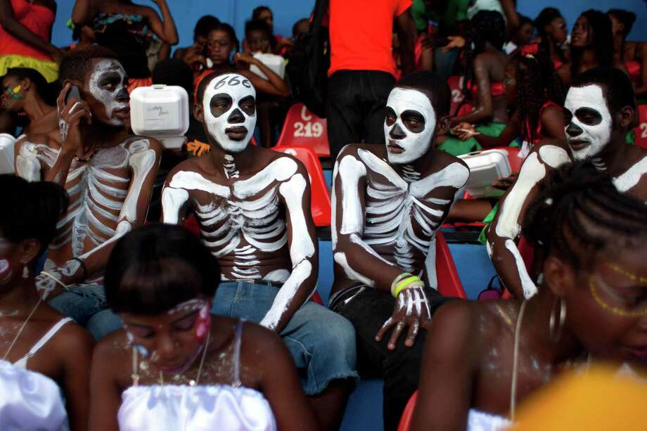 "Revelers wait for the start of the ""Carnival of Flowers"" celebrations in Port-au-Prince, Haiti, Monday, July 29, 2013. Tens of thousands of revelers have poured into downtown Port-au-Prince for the Caribbean nationís second ìCarnival of Flowers,î a three-day celebration President Michel Martelly has revived from the Duvalier era. ( AP Photo/Dieu Nalio Chery) Photo: ASSOCIATED PRESS / AP2013"