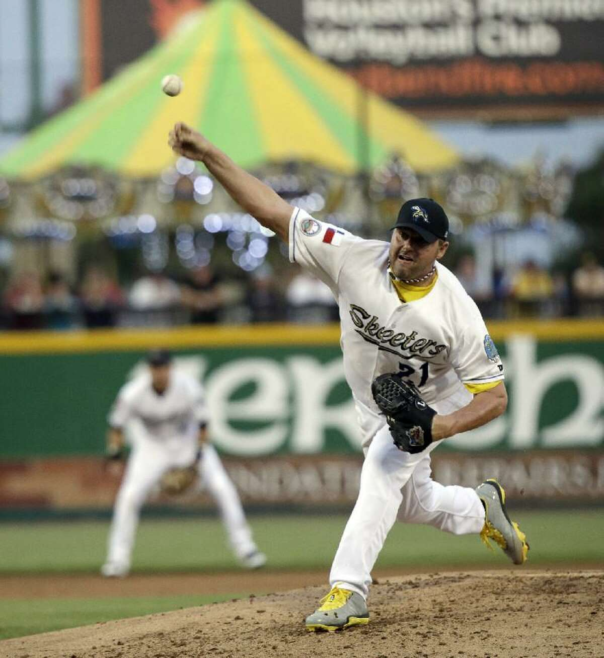 ASSOCIATED PRESS Sugar Land Skeeters pitcher Roger Clemens throws a pitch during a game against the Bridgeport Bluefish Saturday in Sugar Land, Texas. Clemens, a seven-time Cy Young Award winner, signed with the Skeeters of the independent Atlantic League this week.