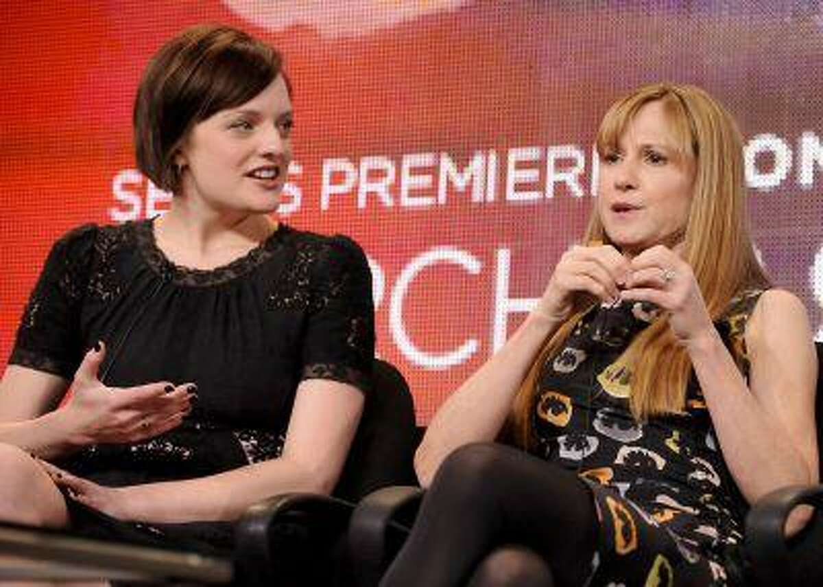 """Actresses Elisabeth Moss and Holly Hunter (R) take part in a panel discussion of Sundance Channel's drama mini series """"Top of the Lake"""" during the 2013 Winter Press Tour for the Television Critics Association in Pasadena, Calif. (Reuters/Gus Ruelas)"""