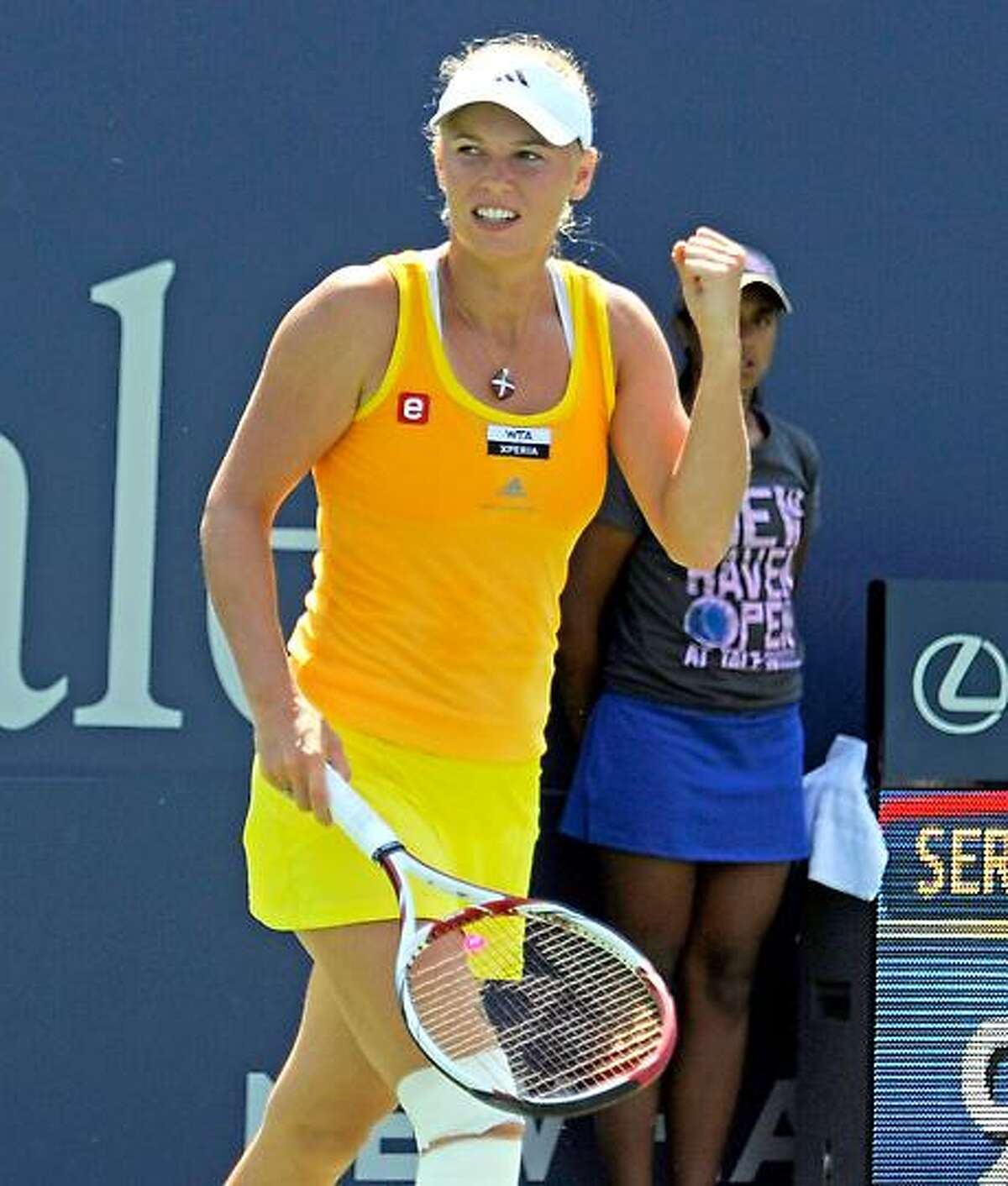 Caroline Wozniacki celebrates afte rshe won her quarterfinal singles match at the New Haven Open in New Haven, Conn., Thursday, Aug. 23, 2012. (Bob Child Photo)