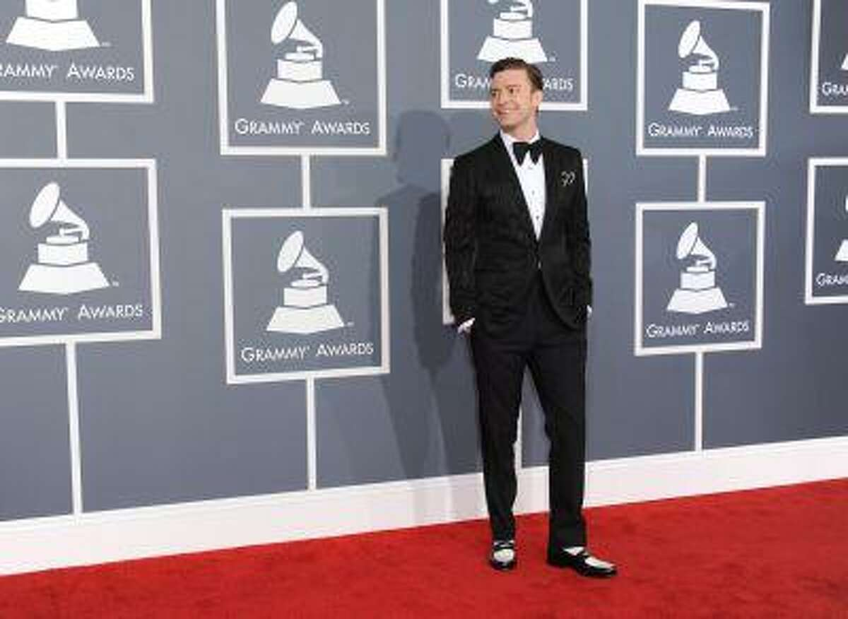"""FILE - In this Feb. 10, 2013 file photo, musician Justin Timberlake arrives at the 55th annual Grammy Awards, in Los Angeles. """"Mad Men"""" star Jon Hamm is going mad over Justin Timberlake's suit and tie, the song and the singer's style. As for Timberlake, Hamm believes the pop star has """"always been a very fashion forward kind of guy."""" (Photo by Jordan Strauss/Invision/AP, File)"""