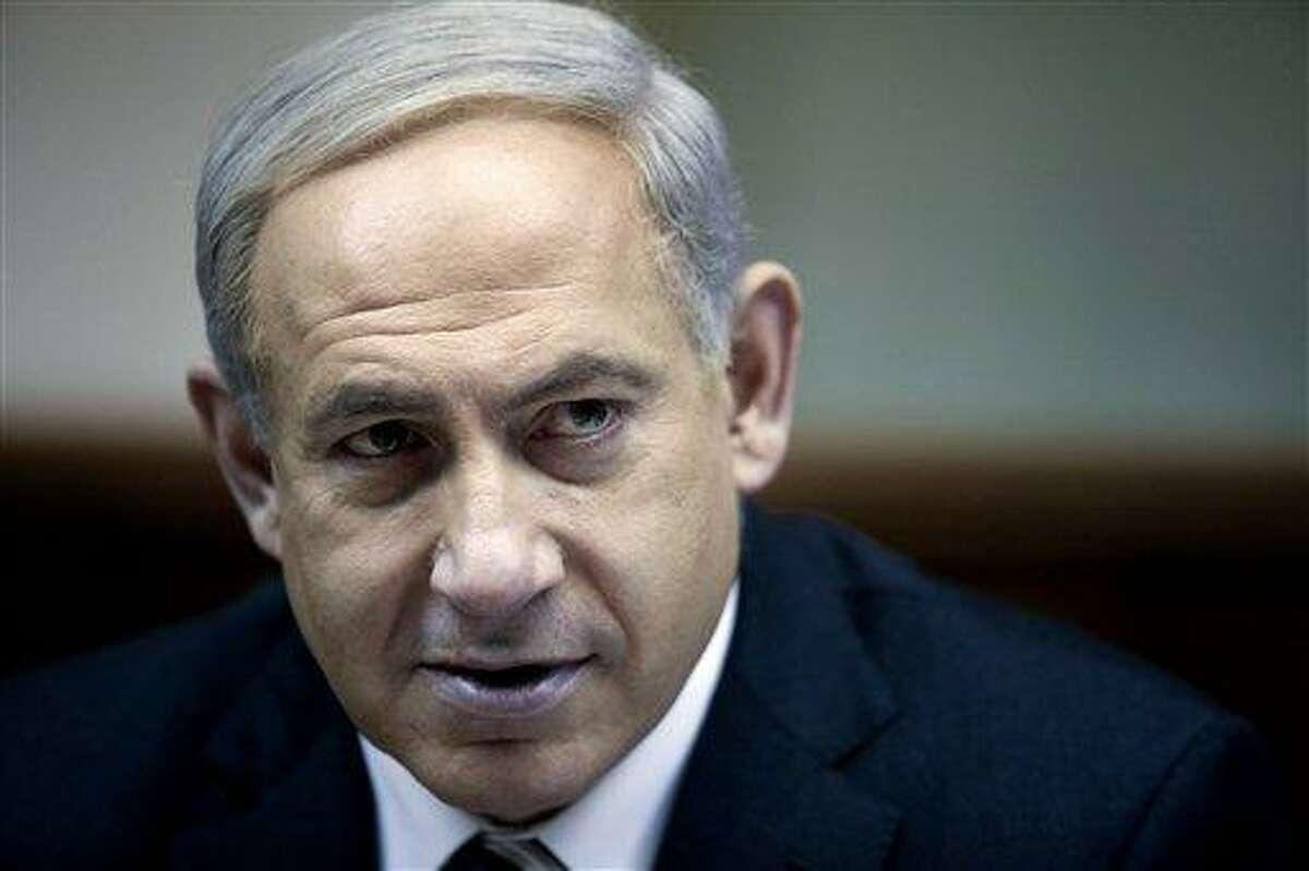 Israeli Prime Minister Benjamin Netanyahu heads the weekly cabinet meeting in his Jerusalem office, Sunday, Dec. 30, 2012. (AP Photo/Abir Sultan, Pool)