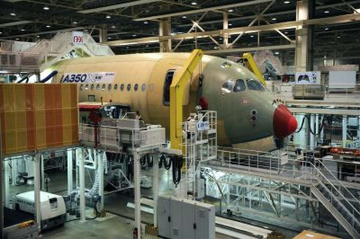 An Airbus long-haul plane A350 XWB (eXtra Wide Body). Airbus is on track to deliver the first A350 XWB by the end of next year.