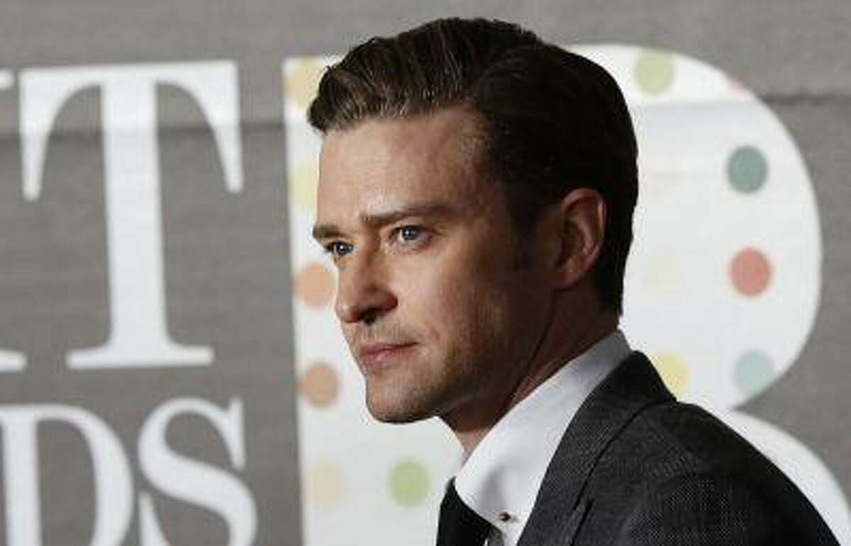U.S. singer Justin Timberlake arrives for the BRIT Awards, celebrating British pop music, at the O2 Arena in London February 20, 2013. REUTERS/Luke Macgregor (BRITAIN - Tags: ENTERTAINMENT) - RTR3E1J7