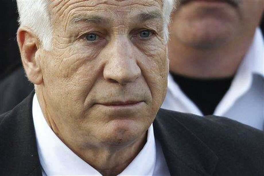 FILE - In this Dec. 13, 2011 file photo,Jerry Sandusky, the former Penn State assistant football coach charged with sexually abusing boys, leaves the Centre County Courthouse in Bellefonte, Pa. A young man who testified against Jerry Sandusky is suing Penn State, blaming the university for how its top officials dealt with complaints that the former assistant football coach was behaving inappropriately with boys. The lawsuit filed Friday, Aug. 24, 2012 by the man, called Victim 1 at Sandusky's trial, said Penn State officials made deliberate decisions not to report Sandusky to authorities.  (AP Photo/Matt Rourke, File) Photo: AP / AP