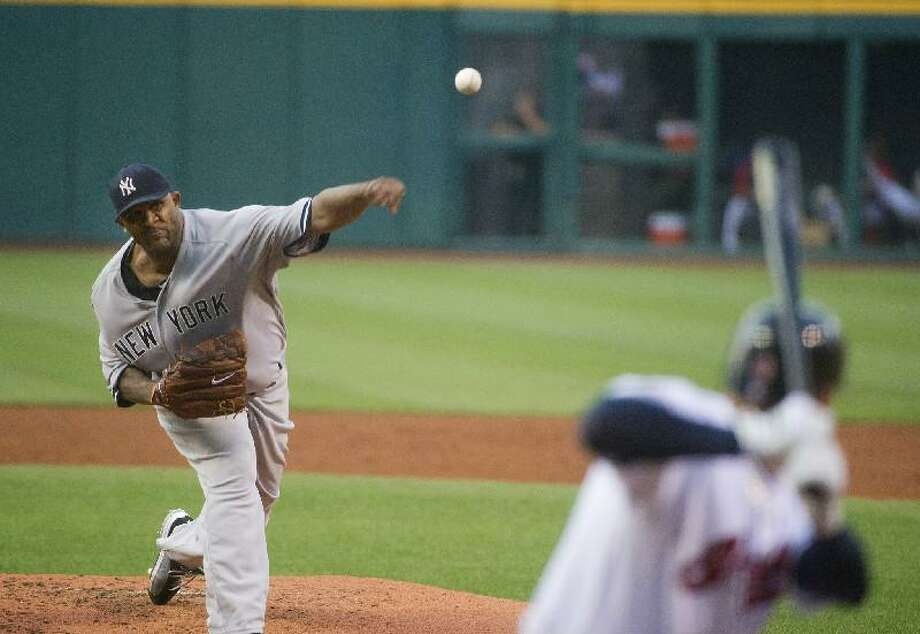 ASSOCIATED PRESS CC Sabathia of the New York Yankees pitches to Asdrubal Cabrera of the Cleveland Indians in the first inning of Friday night's game in Cleveland. The Yankees won the game 3-1. Sabathia threw 7.1 innings of one-run ball in his first start since coming off of the disabled list.
