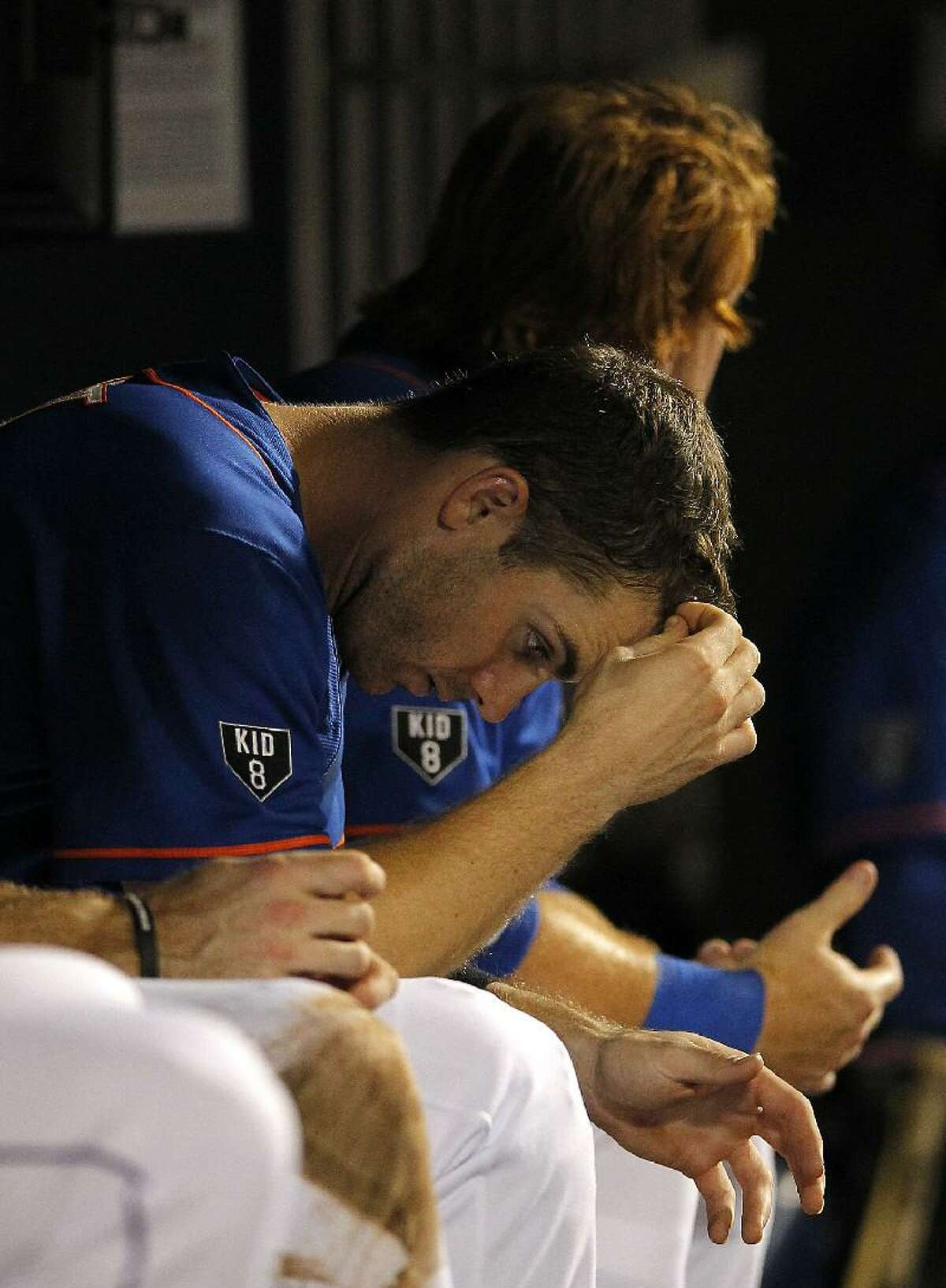 ASSOCIATED PRESS New York Mets' David Wright sits in the dugout while waiting for the final out in the ninth inning of a Mets 3-1 loss to the Houston Astros at Citi Field in New York on Friday.