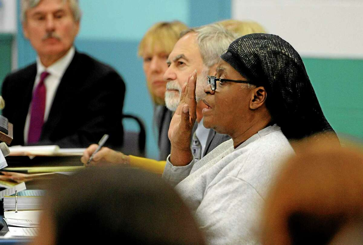 Bonnie Jean Foreshow raises her hand while taking an oath to tell the truth before the Board of Pardons and Parole during her clemency hearing at the J.B. Gates Correctional Institution, Wednesday, Oct. 9, 2013, in East Lyme, Conn.