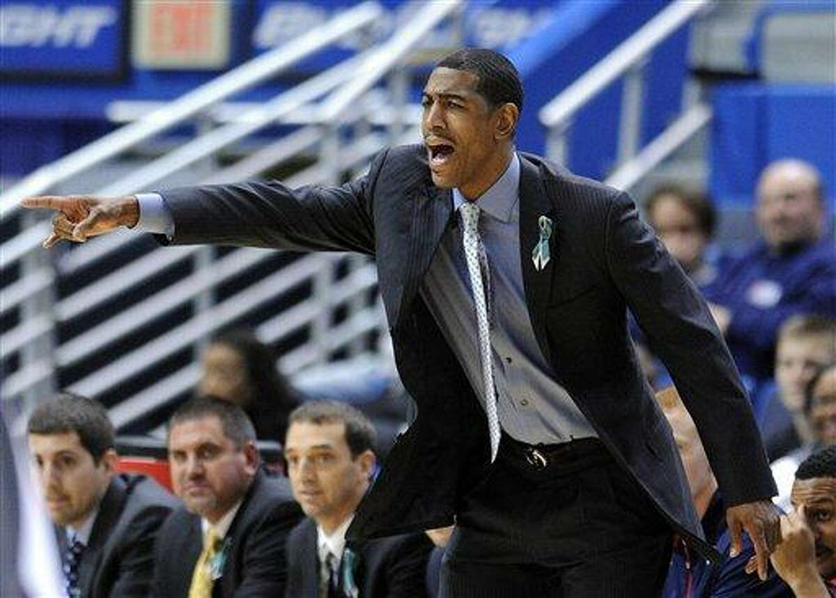 Connecticut coach Kevin Ollie calls to his team during the first half of an NCAA college basketball game against Maryland Eastern Shore in Hartford, Conn., Monday, Dec. 17, 2012. Connecticut won the game 84-50. (AP Photo/Fred Beckham)