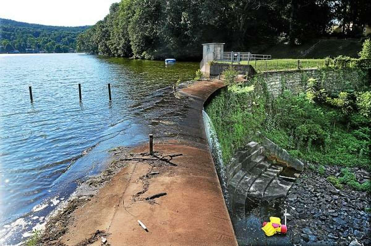 The DEEP, the Bureau of Water Management and the Inland Water Resources Division will be accepting sealed bids for the Lake Beseck Dam improvements on Kings Road in Middlefield until 11 a.m. on Thursday at 79 Elm Street in Hartford. Construction includes partial demolition and construction of existing spillway and gate house structures, construction of new intake and outlet piping, gravel access road, fences and appurtenances and dry fire hydrants. According to Wikipedia, Lake Beseck Dam is owned by DEEP and was created in 1846. The original dam, completed in 1848, was ten feet lower than the current one. The dam was raised five feet in 1852 and 1870 and rebuilt in 1938. Catherine Avalone - The Middletown Press