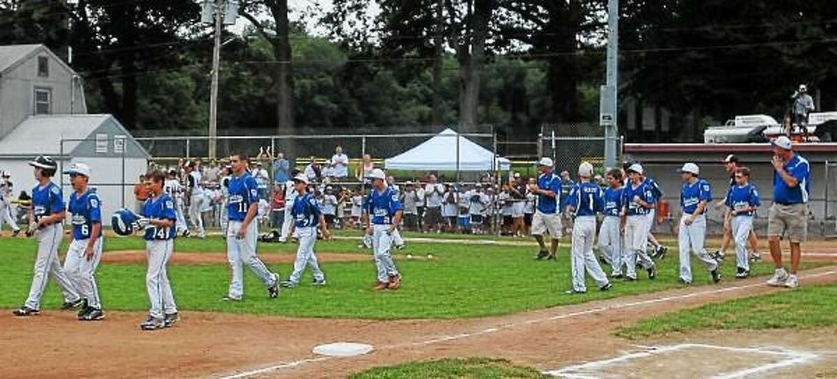 Coginchaug Little League walks off the field after losing to Westport 9-1 in the Little League state U12 Finals. Mary Albl - New Haven Register