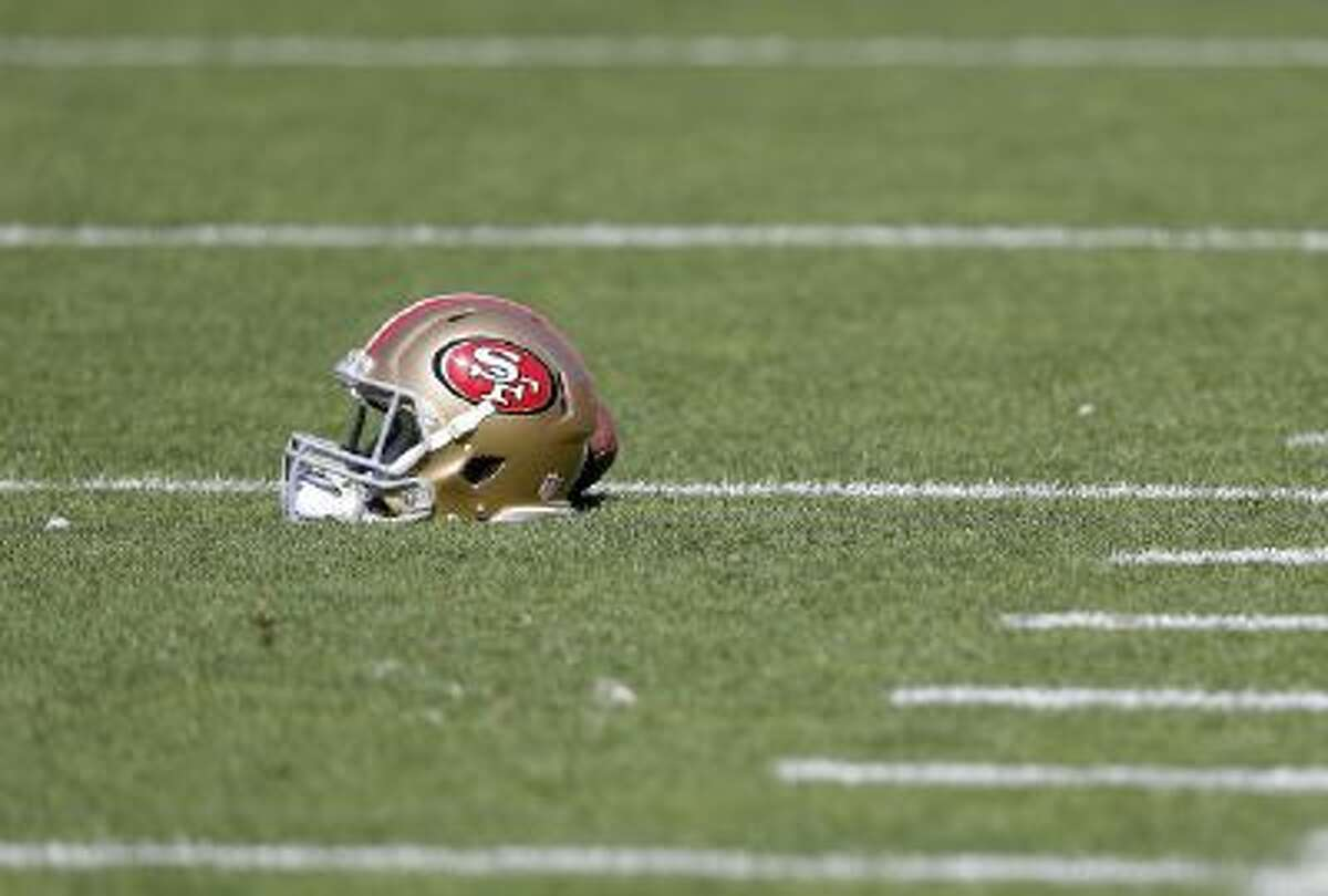A San Francisco 49ers helmet rests on the field before an NFL football game against the Arizona Cardinals in San Francisco, Sunday, Oct. 13, 2013.