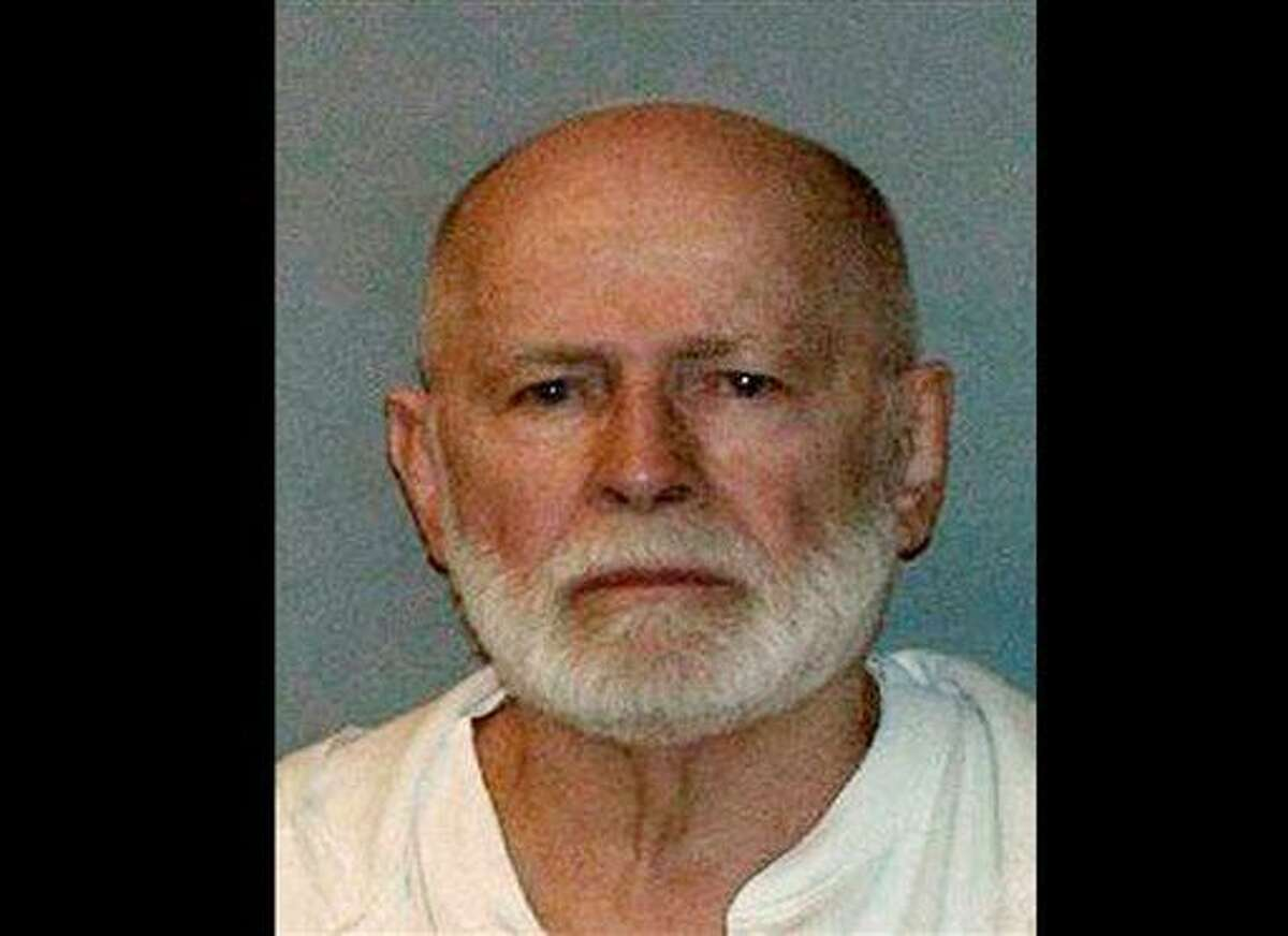 """This undated file booking photo, obtained by WBUR 90.9 - NPR Radio Boston, shows Boston mob boss James """"Whitey"""" Bulger, who was captured on June 22, 2011, in Santa Monica, Calif., after 16 years on the lam. Lawyers for James """"Whitey"""" Bulger acknowledged he ran a lucrative criminal enterprise that took in millions through illegal gambling, extortion and drug trafficking. On Friday, July 26, 2013, when the judge asked attorney J.W. Carney Jr. if Bulger might testify, he said only that he would let her know after his other witnesses testify. The first defense witnesses are to be called Monday, July 29. (AP Photo/WBUR 90.9, File)"""