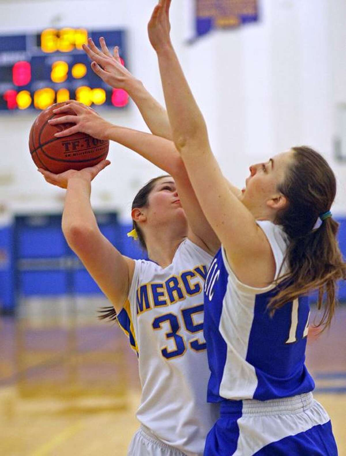 Mercy's Kendra Landy drives against East Catholic Monday in Middletown.
