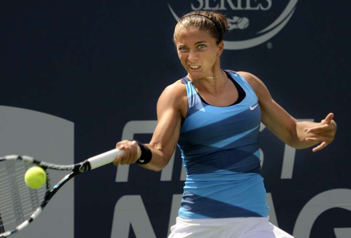 Italy's Sara Errani hits a forehand shot to Spain's Carla Suarez Navarro in their singles match at the New Haven Open in New Haven, Conn., Tuesday, Aug. 21, 2012. (Bob Child Photo)