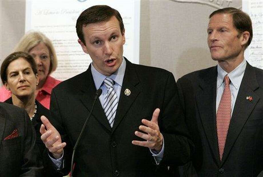 FILE - In this June 15, 2099 file photo, U.S. Rep. Christopher Murphy, D-Conn., speaks at a news conference in Hartford, Conn. Listening to Murphy are from left: Secretary of State Susan Bysiewicz; Murphy; and then-state Attorney General, now U.S. Sen. Richard Blumenthal, D-Conn. Murphy, Bysiewicz and state Rep. William Tong are vying for their party's endorsement for the November 2012 general election to fill the U.S. Senate seat being vacated by Joseph Lieberman, an independent who is retiring. (AP Photo/Bob Child, File) Photo: AP / AP2009