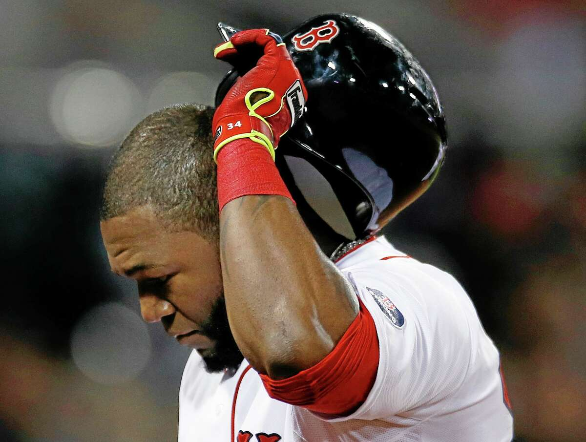 Red Sox designated hitter David Ortiz walks to the dugout after hitting a fly out to end the eighth inning Saturday.