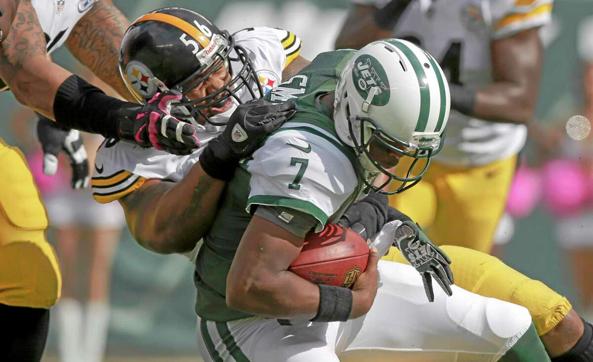 Steelers linebacker LaMarr Woodley (56) sacks Jets quarterback Geno Smith (7) during the first half Sunday.