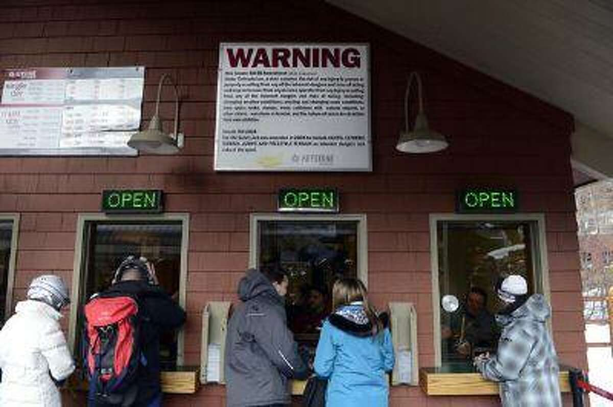 A warning sign greets Keystone Resort skiers and snowboarders at the ticket office on a recent Saturday, reminding them that by Colorado law they assume the risk of injury when skiing and snow riding there. The sign is highly visible throughout all Colorado ski areas. (Photos by Andy Cross, The Denver Post)