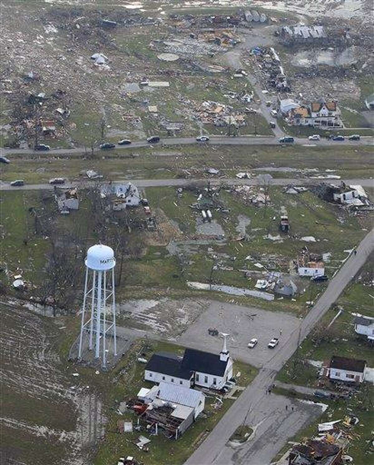 In this aerial photo, debris is strewn about, Saturday in Marysville, Indiana, after a tornado swept through the area Friday. Associated Press