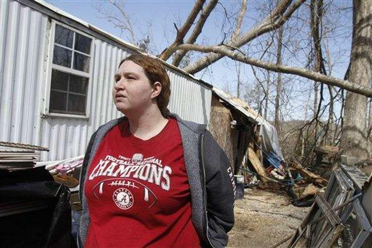 Valerie Holder talks Saturday about the tornado that tore through her neighborhood on Davis Mill Road on Friday night in Harrison, Tenn. Associated Press