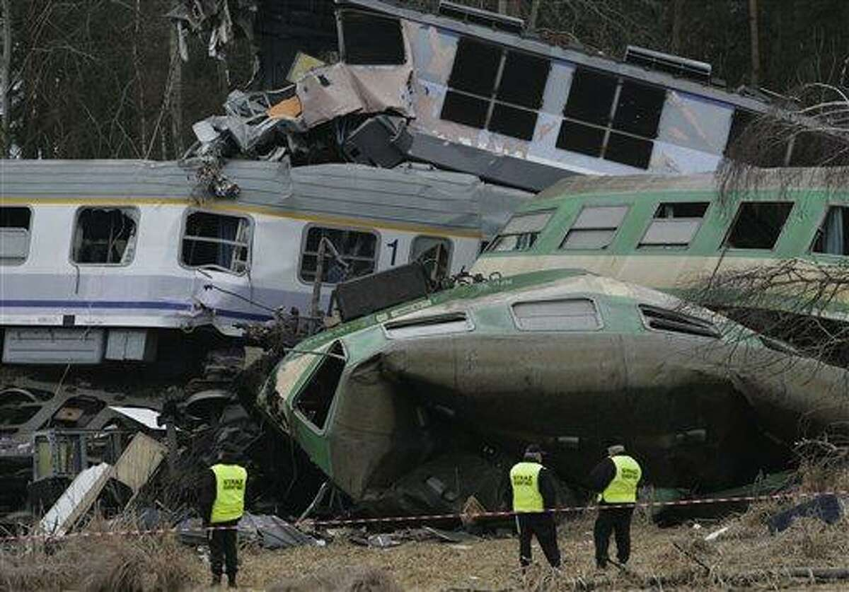 The wreckage of collided trains in Szczekociny, southern Poland, Sunday. Polish prosecutors have opened an investigation into how a train ended up on the wrong tracks after two engines collided head on late Saturday. Associated Press