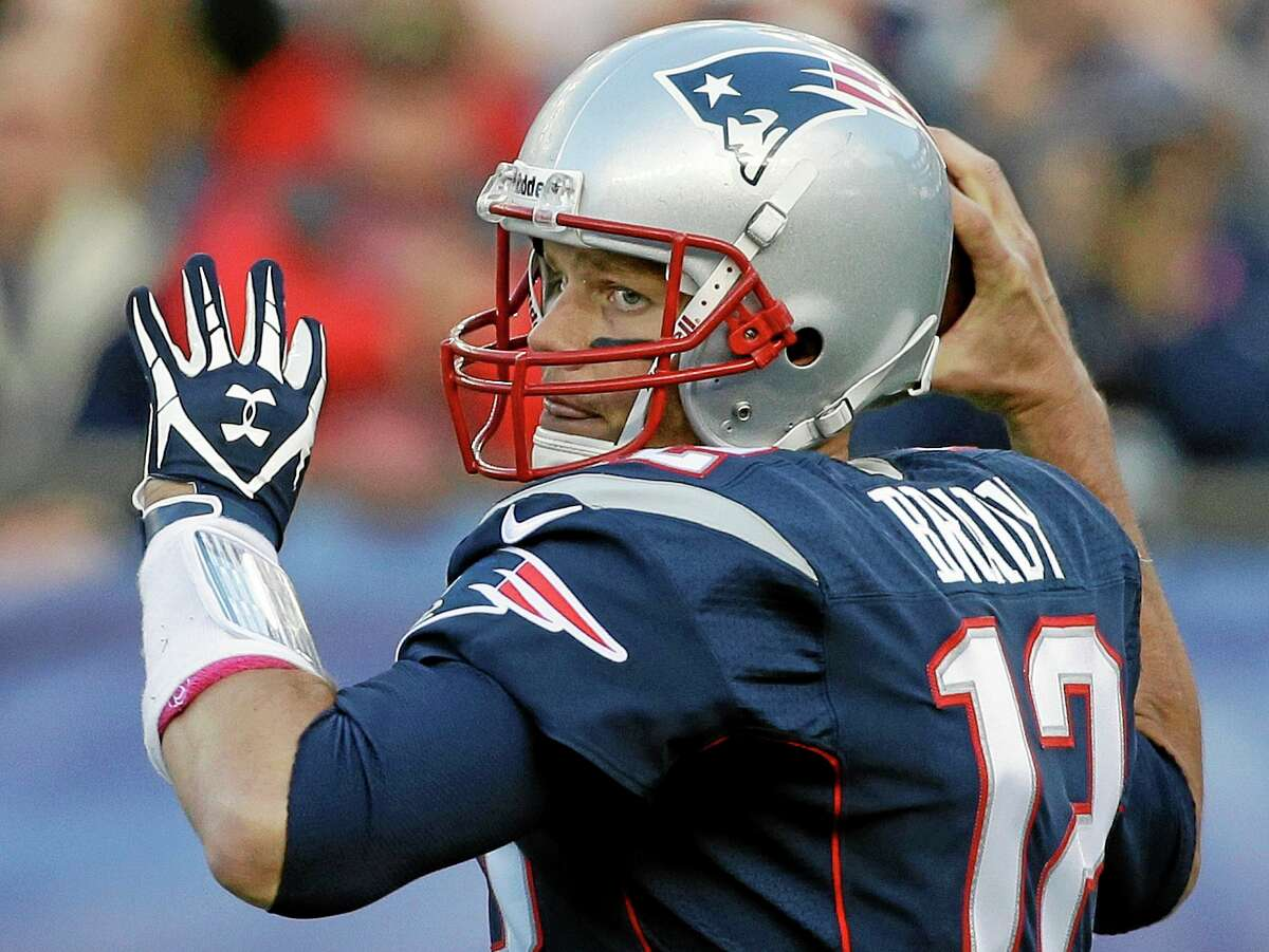 Patriots quarterback Tom Brady looks for a receiver in the first half of Sunday's game against the Saints.