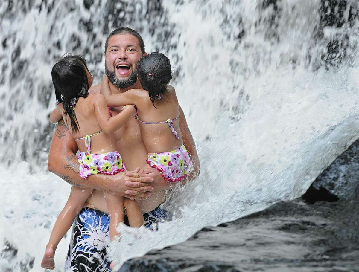 Catherine Avalone - The Middletown Press Meriden resident Henry Matis cools off at Wadsworth Falls in Middlefield with his twin 2 1/2 year old daughters Wednesday afternoon. Temperatures will continue to remain in the 90's and there will be an increase in humidity throughout the week.