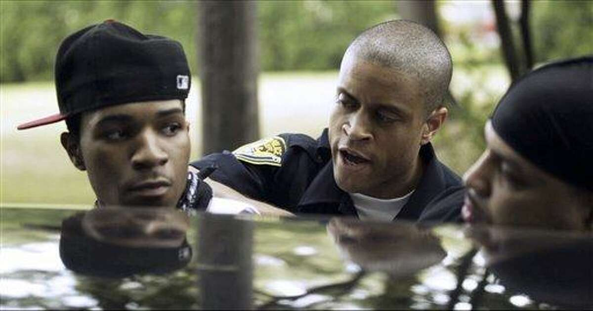 """This undated still image from video, released by director Rashad Frett, shows a scene from an upcoming television police drama """"The Second District,"""" set in Hartford. Hartford police officer Mark Manson took inspiration from his experiences to create the show with a career criminal he met on the job. The show is expected to debut in fall 2012 through a syndication deal bringing it to networks in areas including Chicago, New York and Los Angeles. Associated Press"""