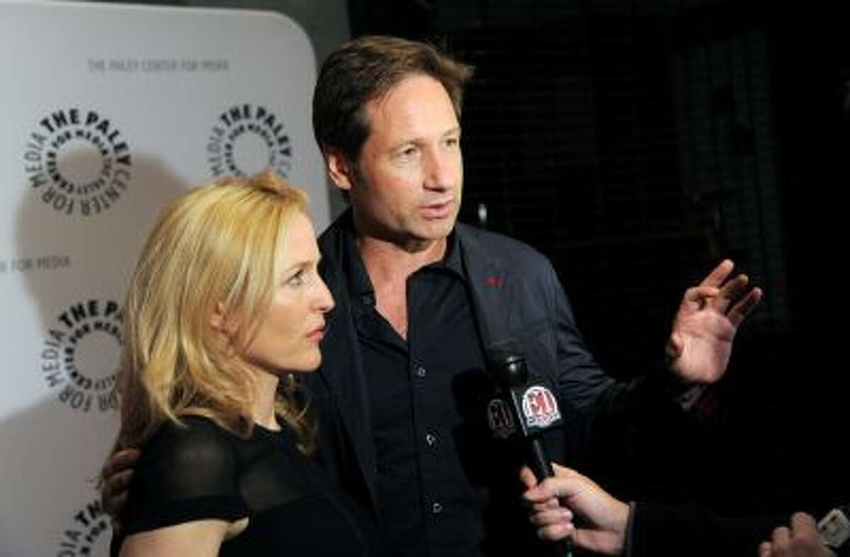 """Actors Gillian Anderson and David Duchovny attend """"The Truth Is Here: David Duchovny and Gillian Anderson on The X-Files"""" at The Paley Center for Media on Saturday, Oct. 12, 2013 in New York."""
