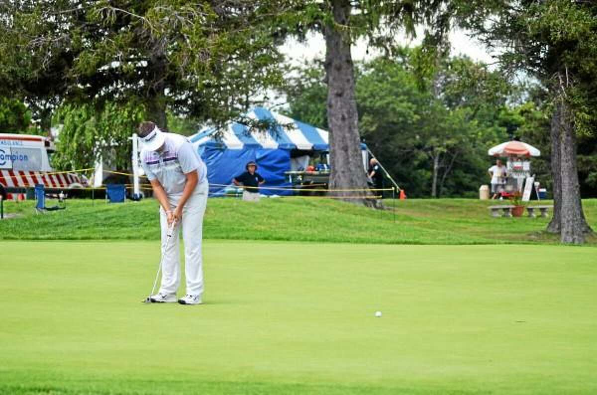 Mike Ballo Jr. putts during Monday's round of 79th Annual Connecticut Open Championship at Torrington Country Club. John Berry - Register Citizen
