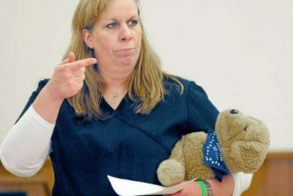 Catherine Avalone/The Middletown Press KatIe Hanks, a veternarian technician at Piper Olson in Middletown and a certified instructor with the Red Cross Pet First Aid & CPR teaches a Pet First Aid & CPR class to members of the 4-H.