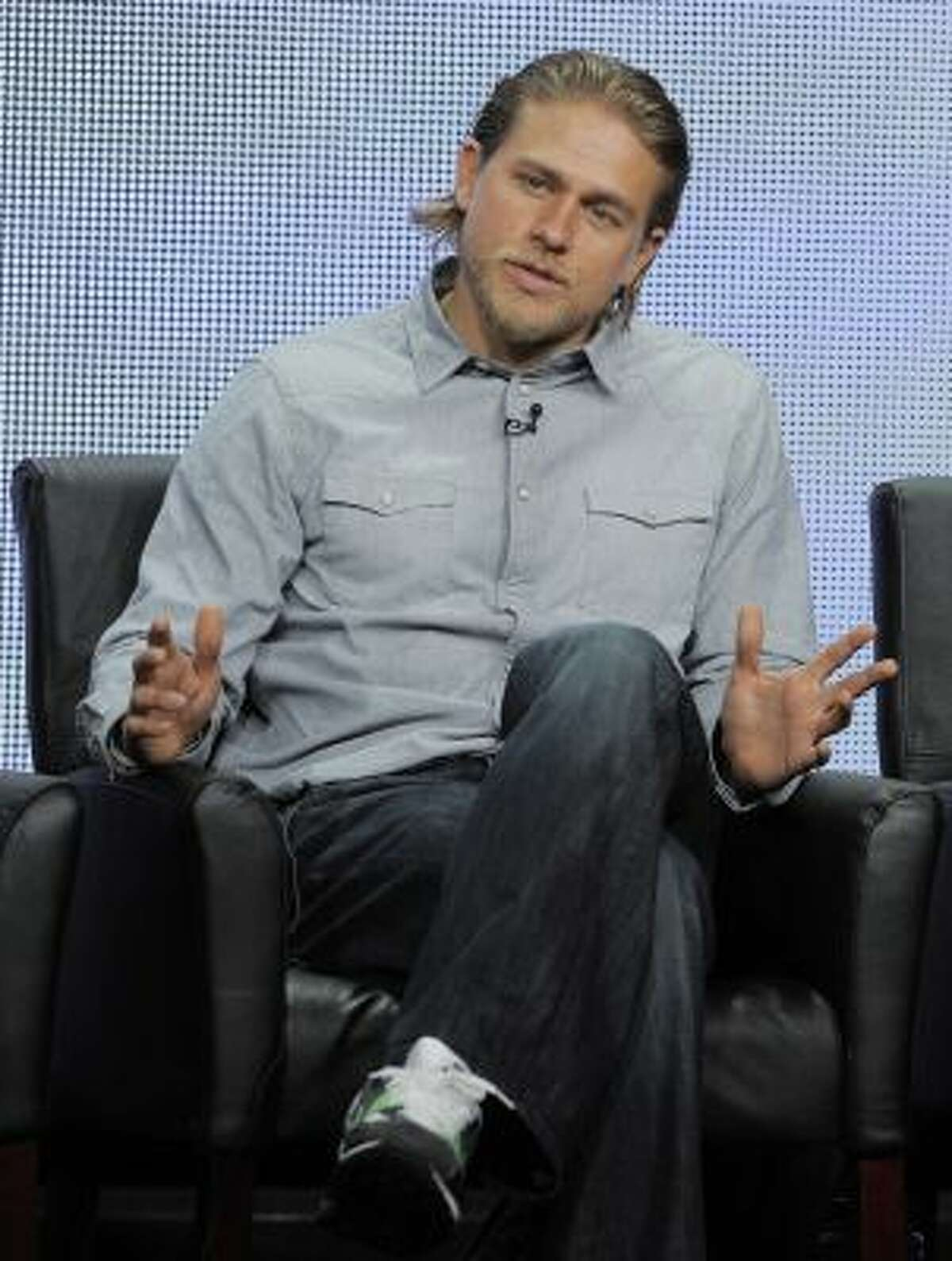 """In this Friday, Aug. 2, 2013 file photo, Charlie Hunnam, a cast member in the FX series """"Sons of Anarchy,"""" answers a reporter's question during the FX 2013 Summer TCA press tour in Beverly Hills, Calif."""