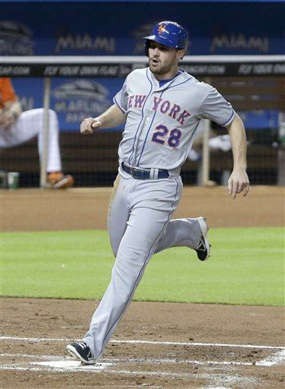 New York Mets' Daniel Murphy crosses home plate to score on a double by David Wright during the third inning of a baseball game against the Miami Marlins, Monday, July 29, 2013 in Miami. The Mets defeated the Marlins 6-5. (AP Photo/Wilfredo Lee)
