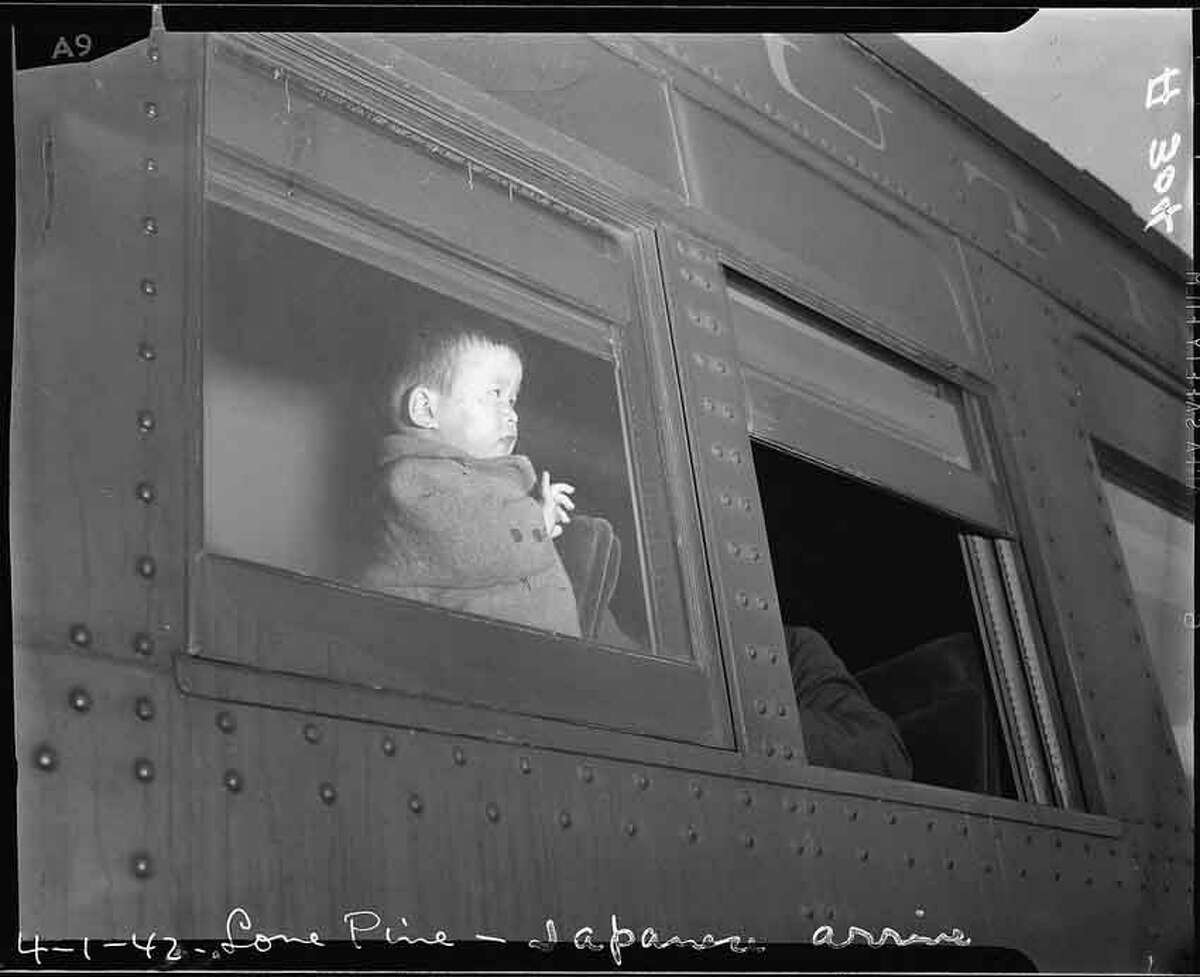 Lone Pine, California. A young evacuee of Japanese ancestry arrives here by train prior to being transferred by bus to Manzanar, now a War Relocation Authority center.