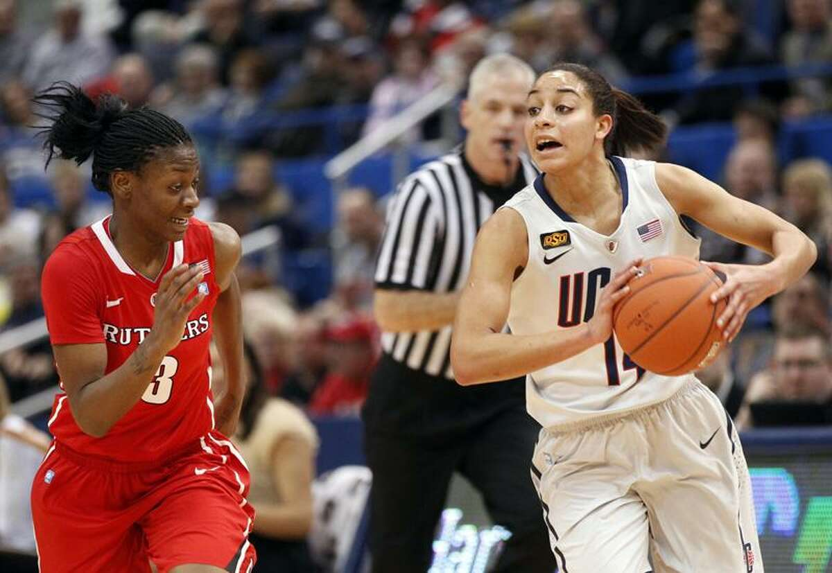 Mar 04, 2012; Hartford, CT, USA; Connecticut Huskies guard Bria Hartley (14) drives the ball against Rutgers Scarlet Knights guard Erica Wheeler (3) during the first half of the quarterfinals of the 2012 Big East Tournament at the XL Center. Mandatory Credit: David Butler II-US PRESSWIRE