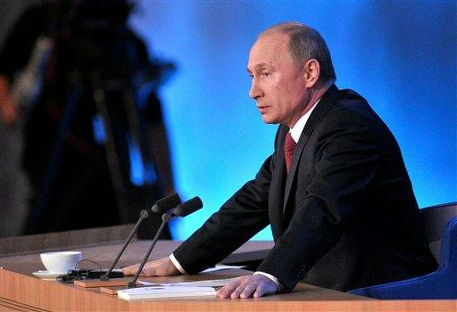 Russian President Vladimir Putin speaks during a news conference in Moscow, Russia, Thursday, Dec. 20, 2012. Putin says a draft bill banning U.S. adoptions of Russian children is a legitimate response to a new U.S. law that calls for sanctions on Russians deemed to be human rights violators. But he has not committed to signing it. (AP Photo/RIA Novosti, Alexei Nikolsky, Presidential Press Service) Photo: ASSOCIATED PRESS / AP2012