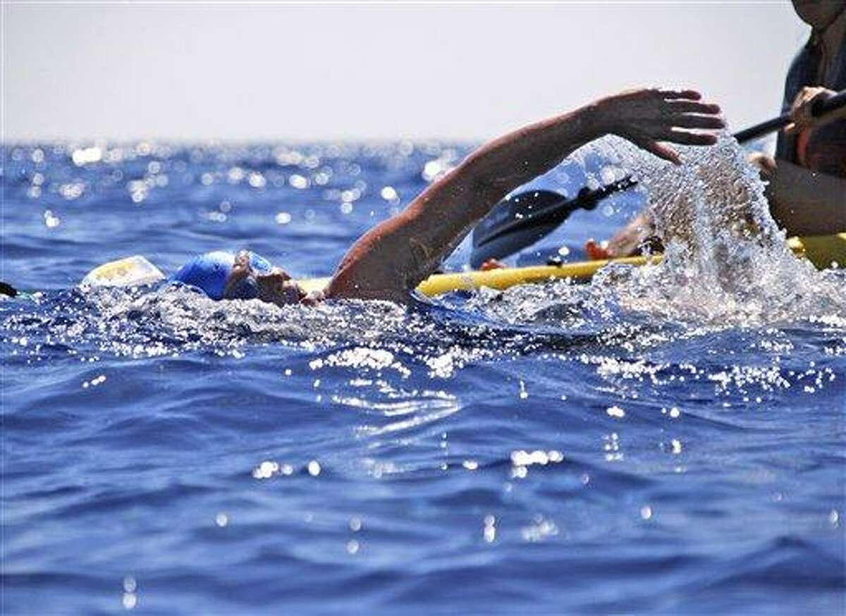 Endurance swimmer Diana Nyad swims in the Florida Straits between Cuba and the Florida Keys Monday. After experiencing problems, Nyad was pulled from the water Tuesday. Associated Press