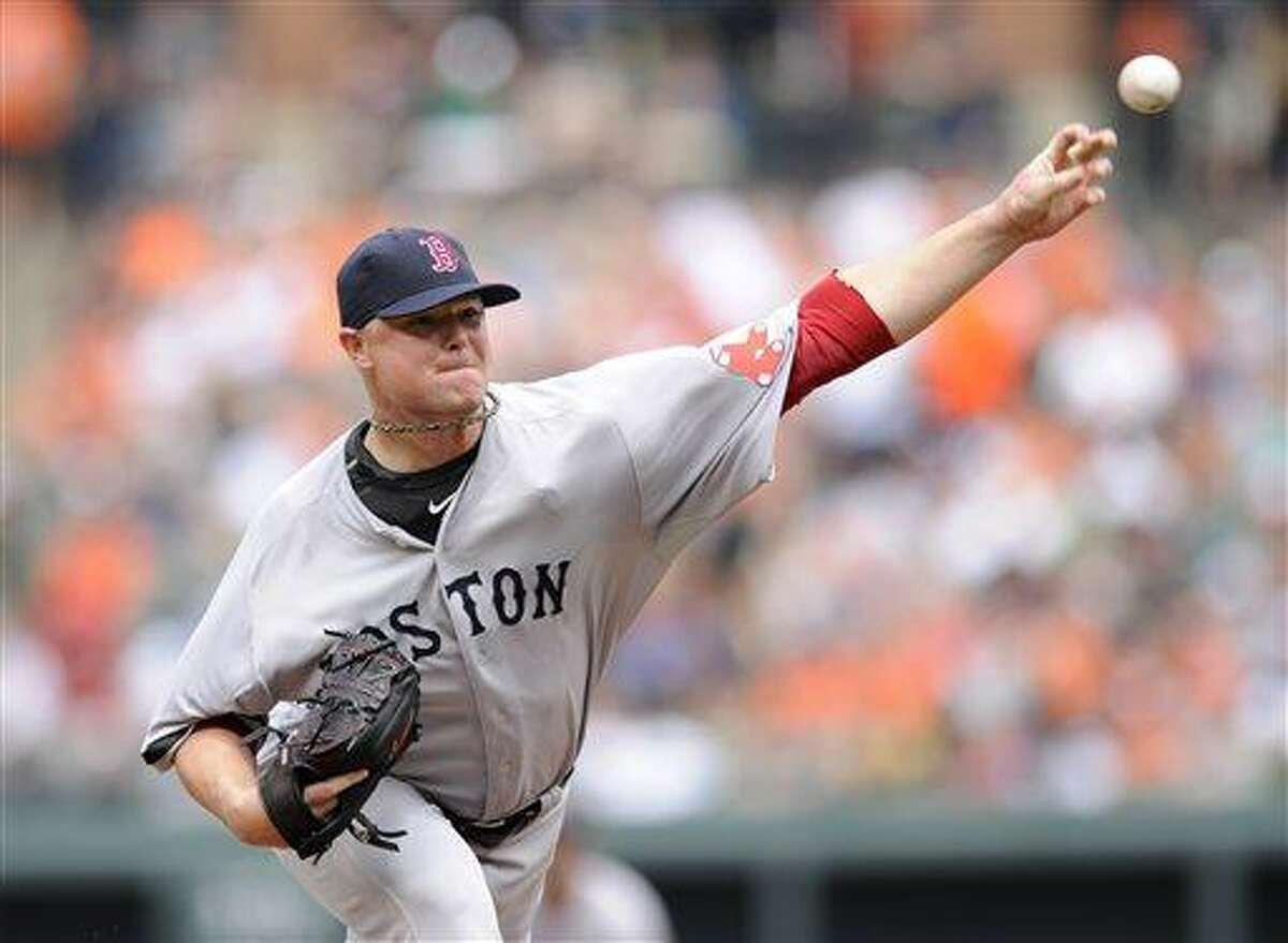 Boston Red Sox starting pitcher Jon Lester delivers against the Baltimore Orioles during the first inning of a baseball game on Sunday, July 28, 2013, in Baltimore. (AP Photo/Nick Wass)