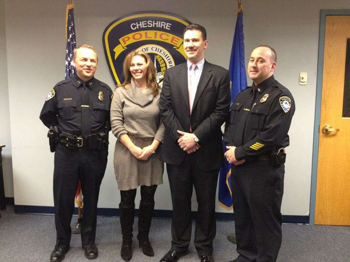 Left to right: Cheshire Police Chief Neil Dryfe, State Farm Spokeswoman Jennifer Young, Cheshire State Farm Agent Derek Gromko and Lt. Brian Pichnarcik, who heads Cheshire's traffic division. Rachel Chinapen/Register