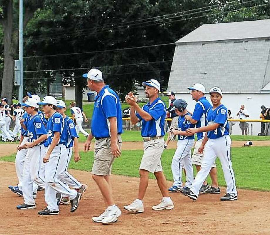 Coginchaug Little League walks off the field after their 9-1 loss to Westport. Photo by Mary Albl - New Haven Register