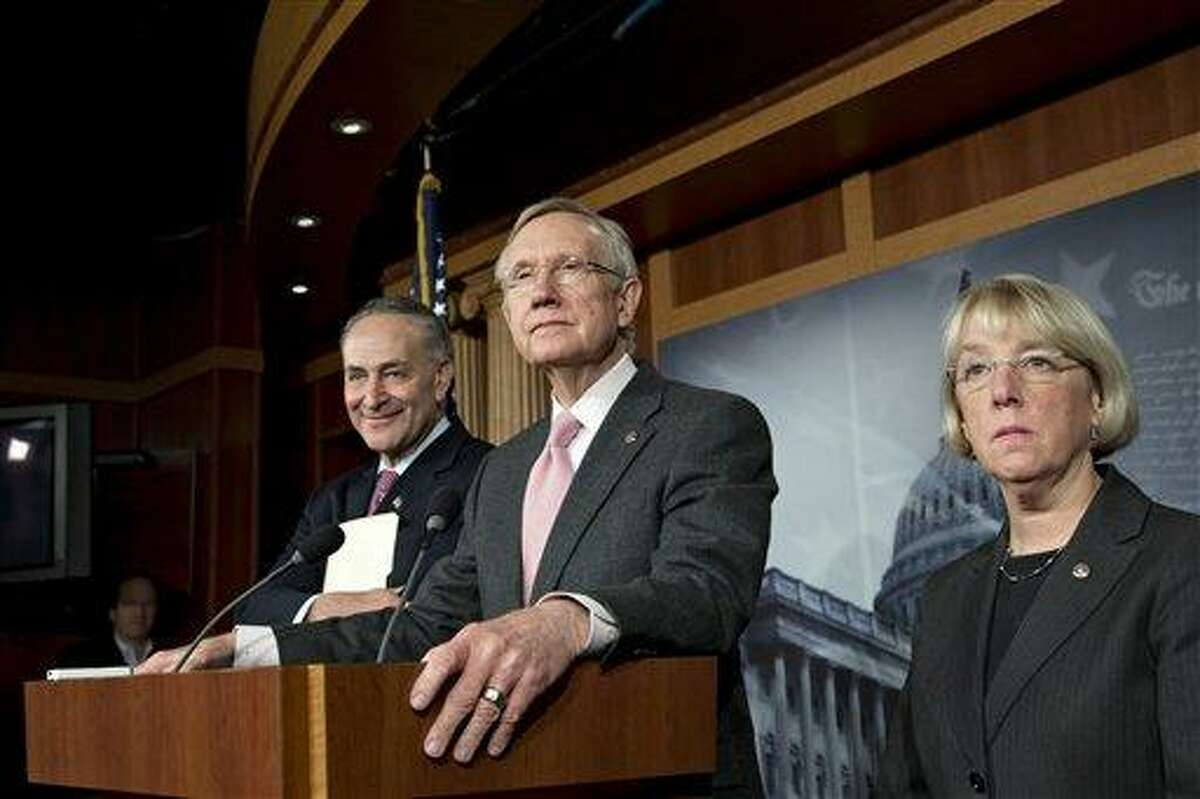 Senate Majority Leader Harry Reid, D-Nev., and Senate Democratic leaders meet with reporters after talks Nov. 29 with Treasury Secretary Timothy Geithner on the fiscal cliff negotiations, at the Capitol in Washington. Associated Press file photo