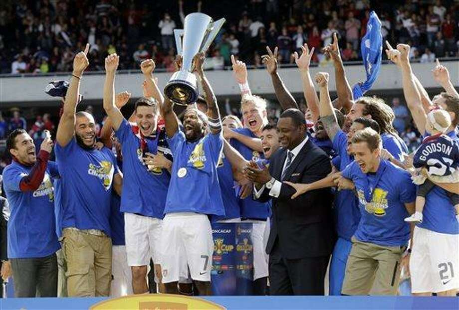 United States players celebrate with the trophy after United States defeated Panama 1-0 during the CONCACAF Gold Cup final match at Soldier Field on Sunday, July 28, 2013, in Chicago. (AP Photo/Nam Y. Huh) Photo: AP / AP