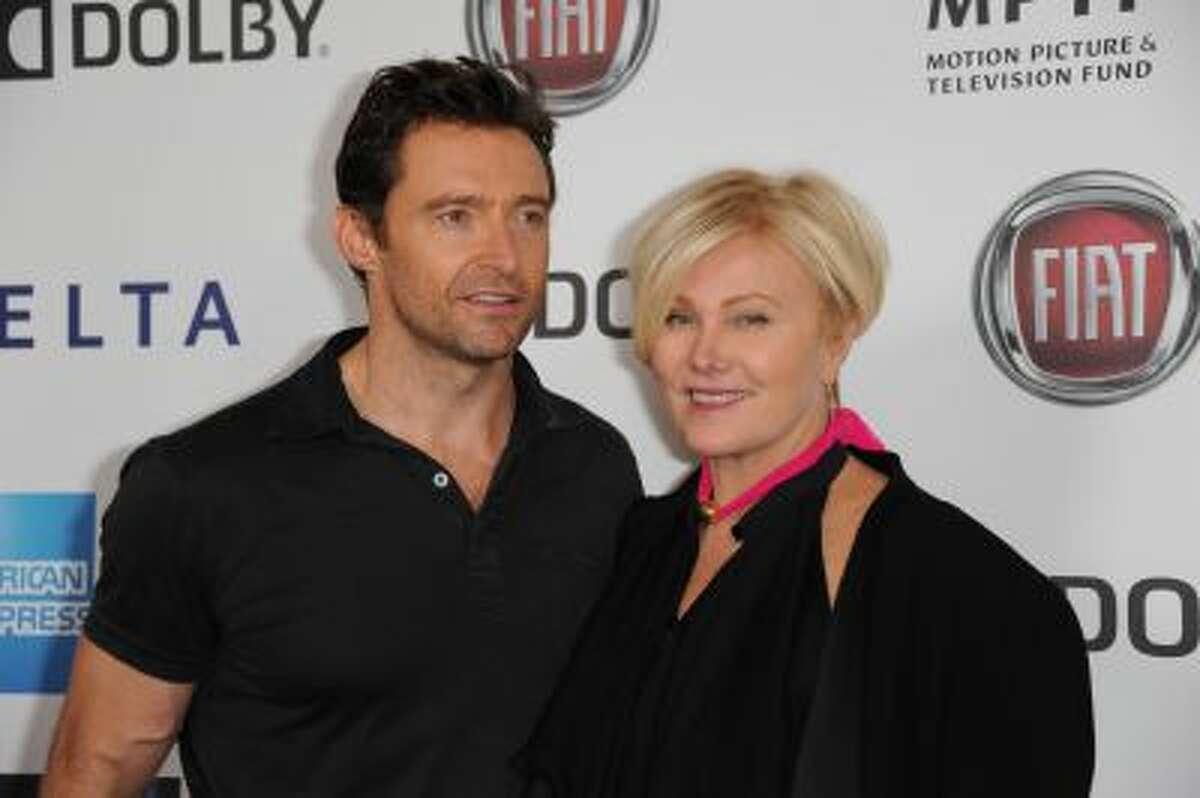 In this Saturday, Oct. 12, 2013 photo, Hugh Jackman, left, and Deborra-Lee Furness pose for photos at the Hugh Jackman One Night Only at the Dolby Theatre in Los Angeles.