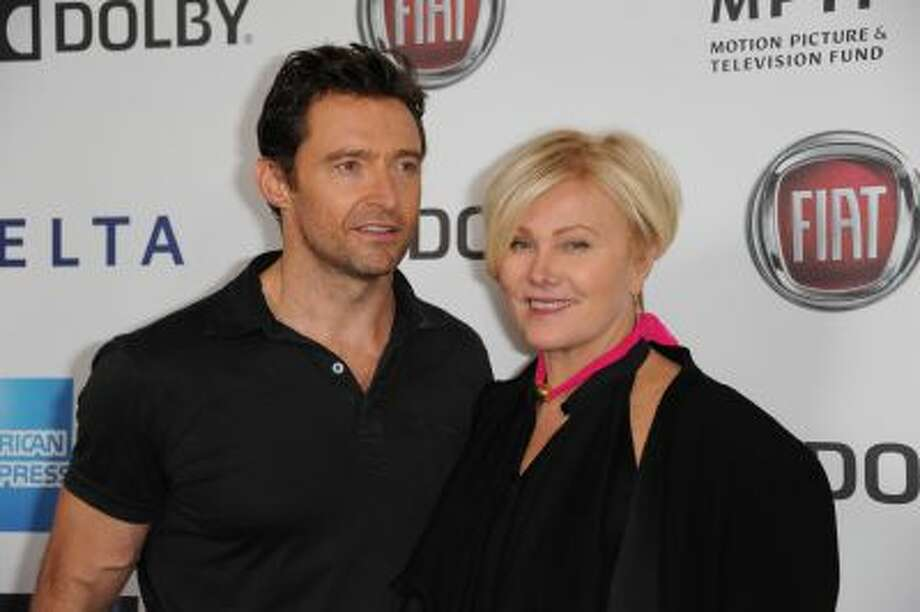 In this Saturday, Oct. 12, 2013 photo, Hugh Jackman, left, and Deborra-Lee Furness pose for photos at the Hugh Jackman One Night Only at the Dolby Theatre in Los Angeles. Photo: Richard Shotwell/Invision/AP / Invision