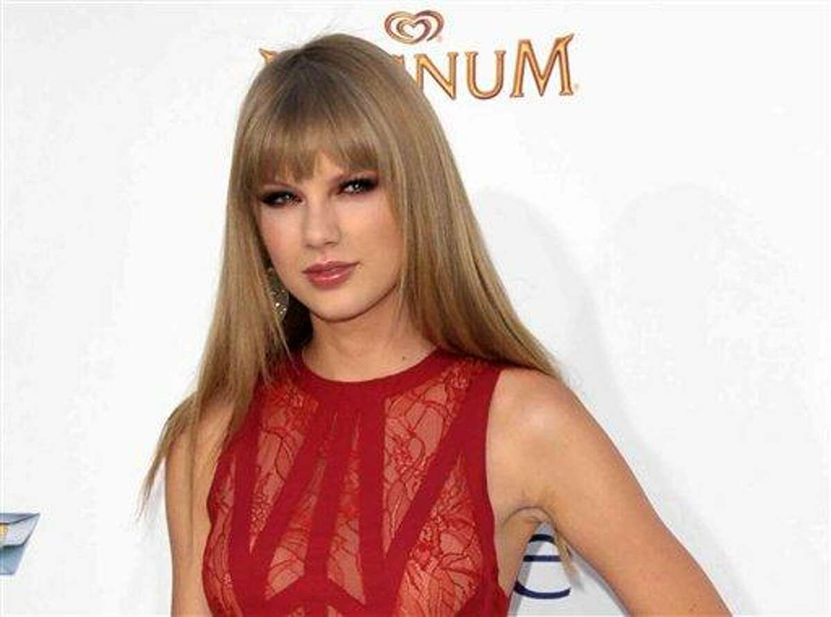 This May file photo shows singer Taylor Swift at the 2012 Billboard Awards at the MGM Grand in Las Vegas, Nev. Swift joined several members of the Kennedy clan, including boyfriend Conor Kennedy, in a somber weekend visit to the grave of his mother on Cape Cod. Swift and Kennedy held hands and at one point appeared to bow their heads in prayer, as did his siblings, while visiting the resting place of Mary Richardson Kennedy. (Photo by John Shearer/Invision/AP, file)