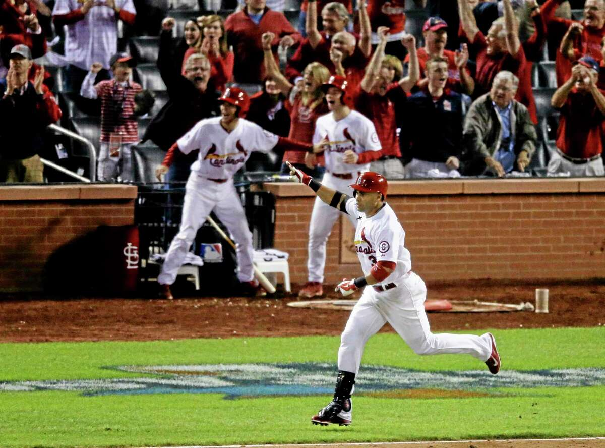 The Cardinals' Carlos Beltran celebrates after hitting his game-winning hit in the 13th inning of Game 1 of the National League championship series against the Los Angeles Dodgers.