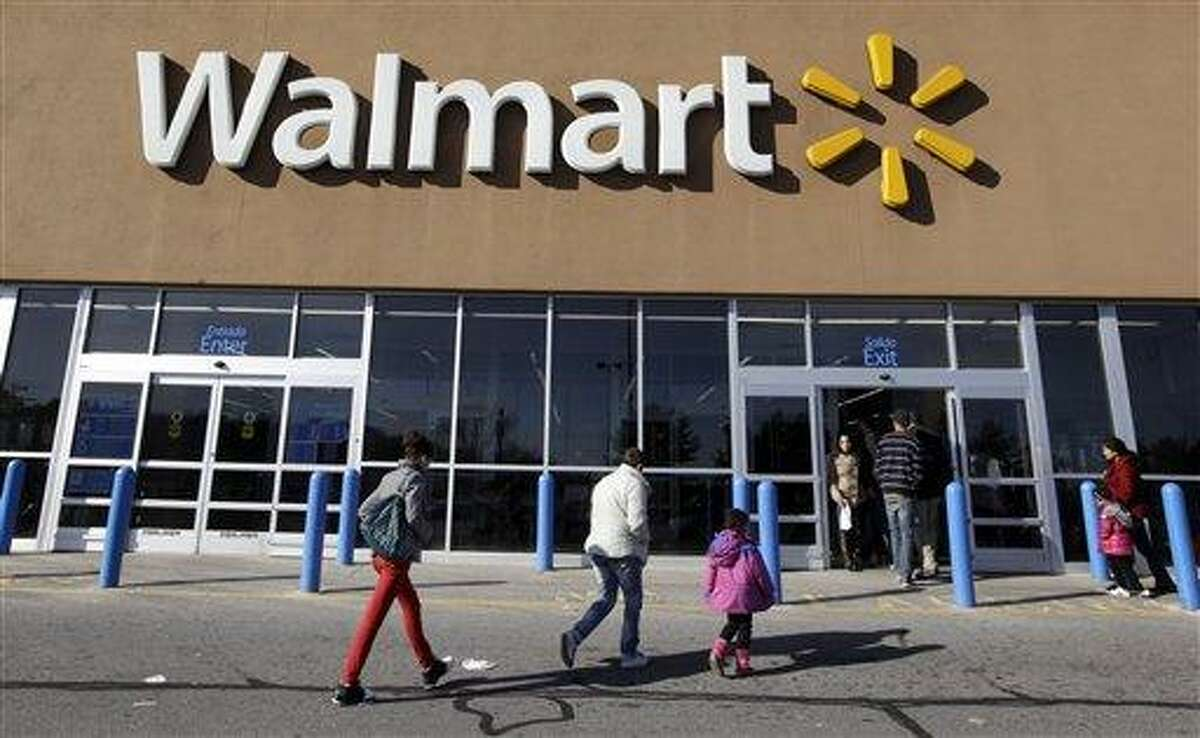 AP FILE - In this Feb. 20, 2012, file photo, customers walk into and out of a Wal-Mart store in Methuen, Mass. This week is tax-free shopping week in Connecticut, and consumers are expected to spend hundreds on clothing and back-to-school items.