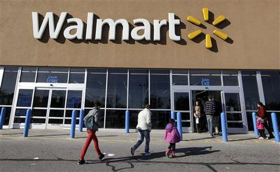 AP FILE - In this Feb. 20, 2012, file photo, customers walk into and out of a Wal-Mart store in Methuen, Mass. This week is tax-free shopping week in Connecticut, and consumers are expected to spend hundreds on clothing and back-to-school items. Photo: AP / AP